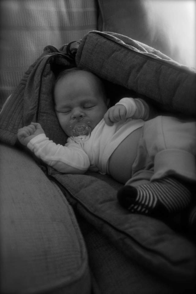 """Taking a nap """"in"""" the sling on the couch"""